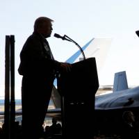U.S. President Donald Trump addresses members of U.S. military and Self-Defense Forces at U.S. Air Force Yokota base in Fussa, on the outskirts of Tokyo, in Sunday. | REUTERS