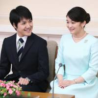 Princess Mako and Kei Komuro speak with reporters in Tokyo's Akasaka district on Sept. 3. The Imperial Household Agency has announced that they will be married on Nov. 4 next year. | KYODO