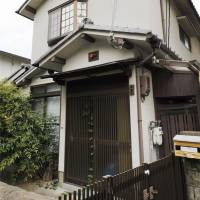 The home of slain elderly man Isao Kakehi and his wife Chisako, a serial killer dubbed Japan's 'black widow,' is seen in Muko, Kyoto Prefecture, in June. | KYODO