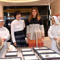Akie and Melania bond over pearls and tea while their husbands hit the links