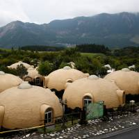 Quake-resistant dome houses at the Aso Farm Land. | REUTERS