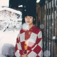 Megumi Yokota is seen wearing a kimono in a January 1977 photo in front of her Niigata Prefecture home. She was abducted by North Korea in November of the same year. | SHIGERU YOKOTA / VIA KYODO