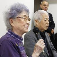 Sakie Yokota (left) speaks at a news conference in Kawasaki on Wednesday, the 40th anniversary of her daughter Megumi's disappearance, as her husband, Shigeru, looks on. | KYODO