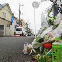 Flowers adorn a street Monday in front of the apartment building in Zama, Kanagawa Prefecture, where alleged serial killer Takahiro Shiraishi has admitted to murdering nine people and dismembering their bodies. | KYODO