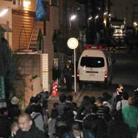 Reporters gather Tuesday in front of an apartment in Zama, Kanagawa Prefecture, after a man was arrested on suspicion of killing nine people there. | KYODO
