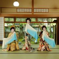 A former tomesode of Ryuto Shinko (center) and two furisode make waves with towels in Niigata Prefecture. | COURTESY OF DAIICHI PRINTING CO.