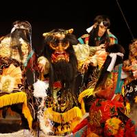 Monster mash: Members of the Yachiyo Kagura Troupe perform in a scene depicting  a fight between some warriors and an ogre during a performance  in Yachiyo Town, Akitakata, Hiroshima.   COURTESY OF AKITAKATA, HIROSHIMA PREFECTURE