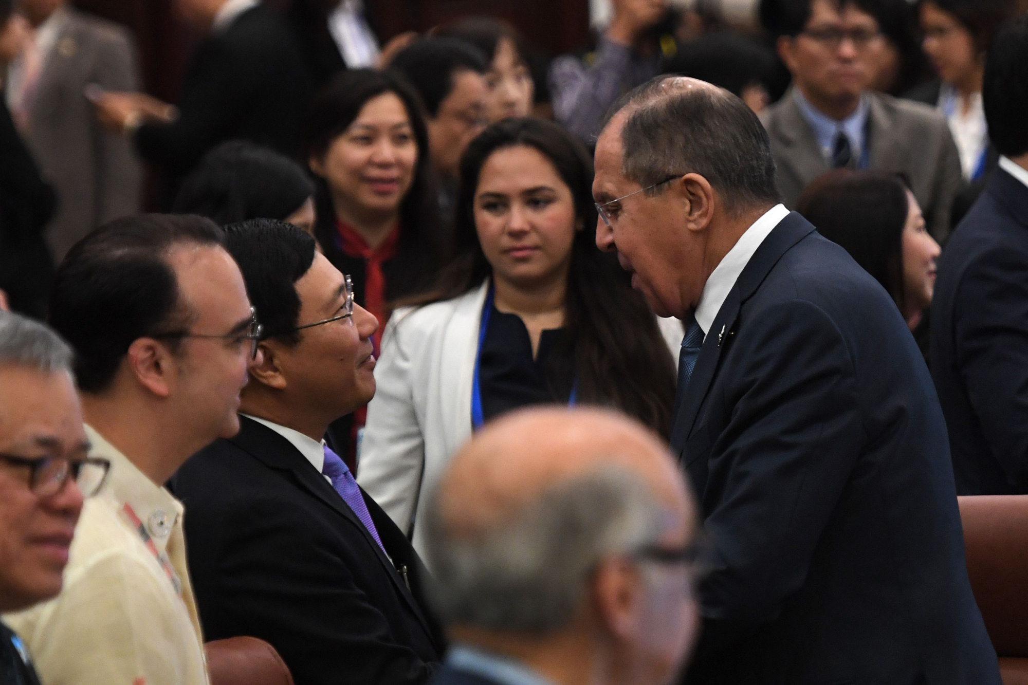 Russian Foreign Minister Sergey Lavrov (right) is greeted by Vietnamese Foreign Minister Pham Binh Minh at the opening of the APEC Ministerial Meeting  in Danang, Vietnam, on Wednesday. Leaders from the 21-member APEC organization will meet in Danang  on Friday and Saturday. | AFP-JIJI