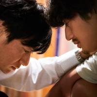 Lighten up: Arata Iura and Eita deal with a harsh childhood experience in 'And Then There Was Light.' | ©SHION MIURA / SHUEISHA INC. ©2017 'AND THEN THERE WAS LIGHT' PRODUCTION COMMITTEE
