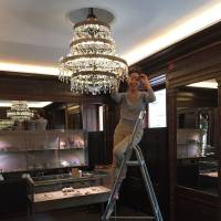 Leading light: Megumi Ito works on a chandelier she designed for a jewelry shop in Vienna.