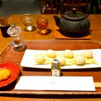 Mochi masters: At Taneya, an order of sticky rice cakes on crackers comes with a wee bottle of extra virgin olive oil and a soy sauce-flavored mousse. | J.J. O'DONOGHUE