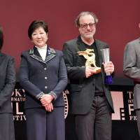 That's a wrap: Grand Prix winner Semih Kaplanoglu (third from left) stands with (from left to right) Seiko Holdings Corp. Director Hiromi Kanagawa, Tokyo Gov. Yuriko Koike and actor Tommy Lee Jones as he accepts the Tokyo International Film Festival's Grand Prix for his film 'Grain,' as well as the world's first GPS solar watch as a prize from Seiko. | YOSHIAKI MIURA