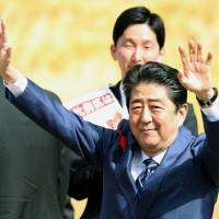 So much to say: Shinzo Abe waves to the crowd on his way to give a campaign speech in Fukushima on Oct. 10. | KYODO