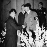 British Prime Minister Neville Chamberlain is greeted by Adolf Hitler in Germany before signing the Munich Agreement on Sept. 29, 1938.   BUNDESARCHIV