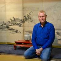 Hail, seiza: Author and self-confessed 'public works consultant' Alex Kerr sits seiza-style in his living room in Kameoka, Kyoto Prefecture. 'You know, my moment came,' he says. 'It's not at an opportune time, but it came and now I need to go through with it.' | J.J. O'DONOGHUE