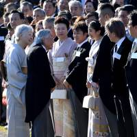 Chatting with the royals: The Imperial couple speak to guests at the autumn Imperial garden party at the Akasaka Imperial Garden in Tokyo. | AFP-JIJI