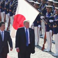U.S. President Donald Trump reviews an honor guard with Prime Minister Shinzo Abe at Akasaka State Guest House in Tokyo on Monday. This year's annual Malabar exercise involving Japan, the U.S. and India was the largest so far. | AFP-JIJI