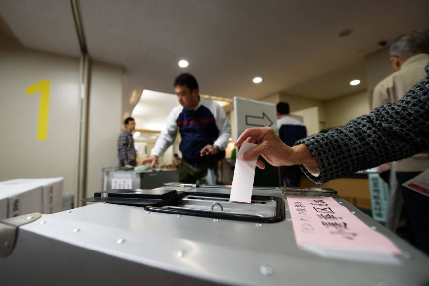 At the polls, a sweep for Abe and  a rubber stamp for Japan's Supreme Court judges