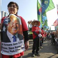 South Korean protesters against North Korea stage a rally in Seoul on Sunday to welcome U.S. President Donald Trump, who arrived in South Korea on Tuesday for a two-day visit.   AP