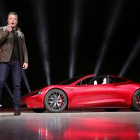 Tesla CEO Elon Musk unveils the Roadster 2 during a presentation in Hawthorne, California, on Nov. 16. | REUTERS