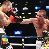 Sergey Lipinets lands a punch on Akihiro Kondo during their IBF super lightweight title fight at Barclays Center in New York on Saturday. | KYODO