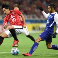 Urawa Reds striker Shinzo Koroki (left) controls the ball during the second leg of the Asian Champions League final against Al Hilal at Saitama Stadium on Nov. 25. | AFP-JIJI