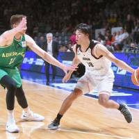 Japan's Yudai Baba looks for a way past an Australian player during their FIBA World Cup qualifier on Monday in Adelaide, Australia. | KYODO