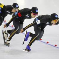Japan's Nana Takagi, Ayana Sato and Miho Takagi (from left) compete in the women's team pursuit race at the Speedskating World Cup in Heerenveen, Netherlands. | AP