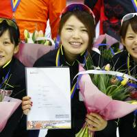 (From left) Miho Takagi, Ayana Sato and Nana Takagi celebrate setting a new world record in the women's team pursuit race at the Speedskating World Cup on Friday. | AP