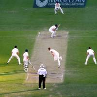 England's Stuart Broad bowls a short delivery to Australia's Shaun Marsh on Friday during the final over of the second day of the first Ashes test in Brisbane, Australia. | REUTERS