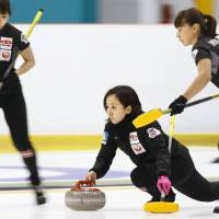 The Japanese team, LS Kitami, competes at the Pacific-Asia Curling Championships on Wednesday in Erina, Australia. | KYODO