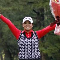 Ai Suzuki celebrates after clinching the Japan LPGA Tour money title on Sunday. | KYODO