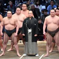 The current scandal yokozuna Harumafuji (front, left) is embroiled in may be indicative of some of the inherent problems in sumo culture. | KYODO