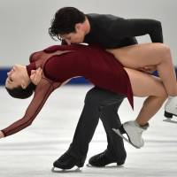 Tessa Virtue and Scott Moir perform their free dance program at the NHK Trophy in Osaka on Sunday. | AFP-JIJI