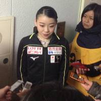 Rika Kihira speaks to reporters after the women's short program on Saturday. Kihira is in sixth place with 57.89 points. | JACK GALLAGHER
