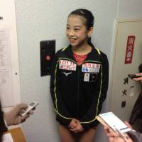 Riko Takino is interviewed at the Japan Junior Championships on Saturday. Takino is in fifth place after the women's short program. | JACK GALLAGHER