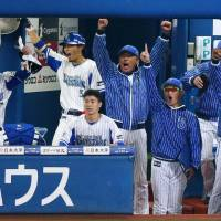 The BayStars bench celebrates Shuto Takajo's home run in the seventh inning of Wednesday's game. | KYODO