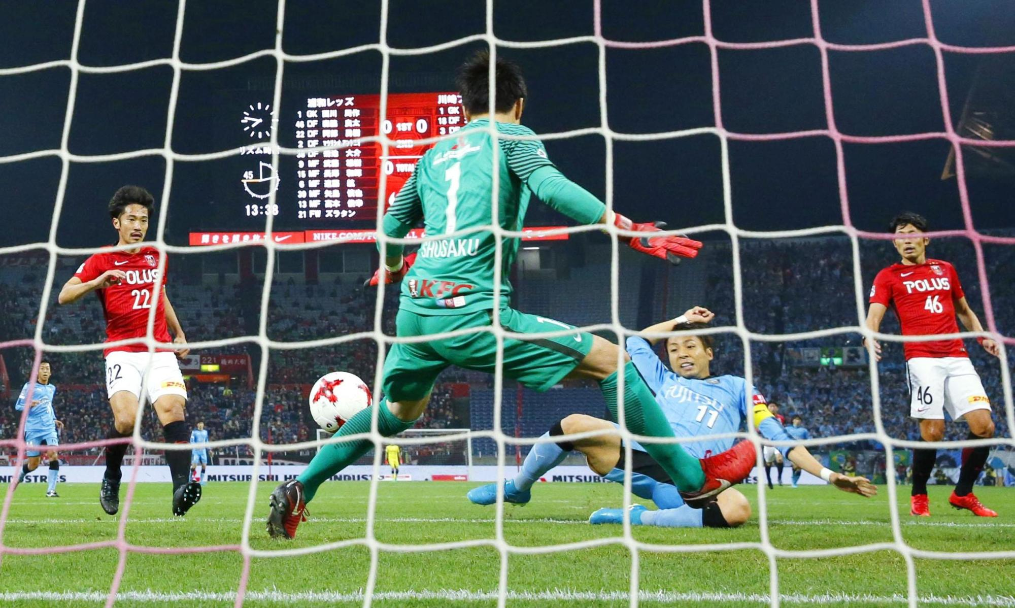 Kawasaki Frontale's Yu Kobayashi (11) scores the only goal of his team's 1-0 win over Urawa Reds at Saitama Stadium in the J. League on Wednesday. | KYODO