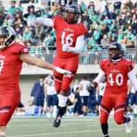 Frontiers linebackers Trashaun Nixon (16) and Al-Rilwan Adeyami (40) react after stopping the Seagulls' offense late in Sunday's game.   KAZ NAGATSUKA