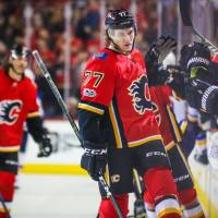 Flames burn Blues in wild final period