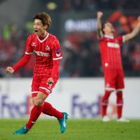Cologne's Yuya Osako celebrates after scoring a goal against BATE Borisov on Thursday in the Europa League. | REUTERS