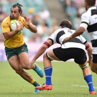 Australia's Karmichael Hunt (left) seen in action in a rugby union match last weekend is sidelined with a neck injury. He won't play against Japan on Saturday at Nissan Stadium. | AFP-JIJI