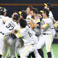 The Fukuoka SoftBank Hawks celebrate their Japan Series-clinching victory in Game 6 over the Yokohama BayStars on Saturday night at Yafuoku Dome. The Hawks won 4-3 in 11 innings. | KYODO