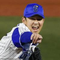 BayStars closer Yasuaki Yamasaki is fired up after getting out of a bases-loaded jam  in the ninth inning on Thursday night against the Hawks. | KYODO