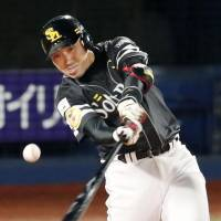 Hawks cleanup hitter Seiichi Uchikawa delivers a run-scoring hit in the first inning on Thursday. | KYODO