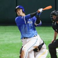 Yokohama's Hiroyuki Shirasaki whacks a solo homer to lead off the fifth inning in Game 6. | KYODO