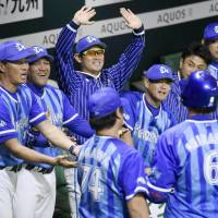 The BayStars are fired up in their dugout in the fifth inning, when they scored three runs and took the lead. | KYODO