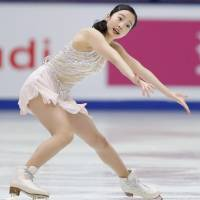 Marin Honda skates in the women's short program at the Cup of China on Friday in Beijing. Honda is in sixth place. | KYODO