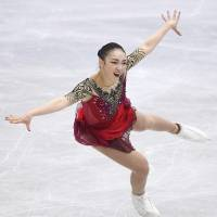 Rika Hongo competes during the women's short program on Friday. She is in fourth place (65.17 points) heading into Saturday's free skate. | KYODO