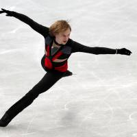Sergei Voronov skates in the men's short program at the NHK Trophy on Friday night. Voronov leads the field with 90.06 points. | REUTERS